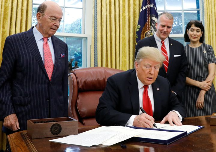 President Donald Trump signing the Save Our Seas Act in the Oval Office on Oct. 11, 2018.