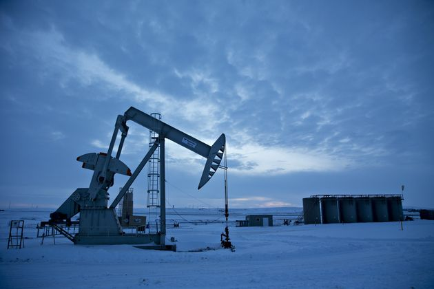 A pump jack operating as a drill rig sits on a well pad in the Bakken Formation in Williston, North Dakota,...
