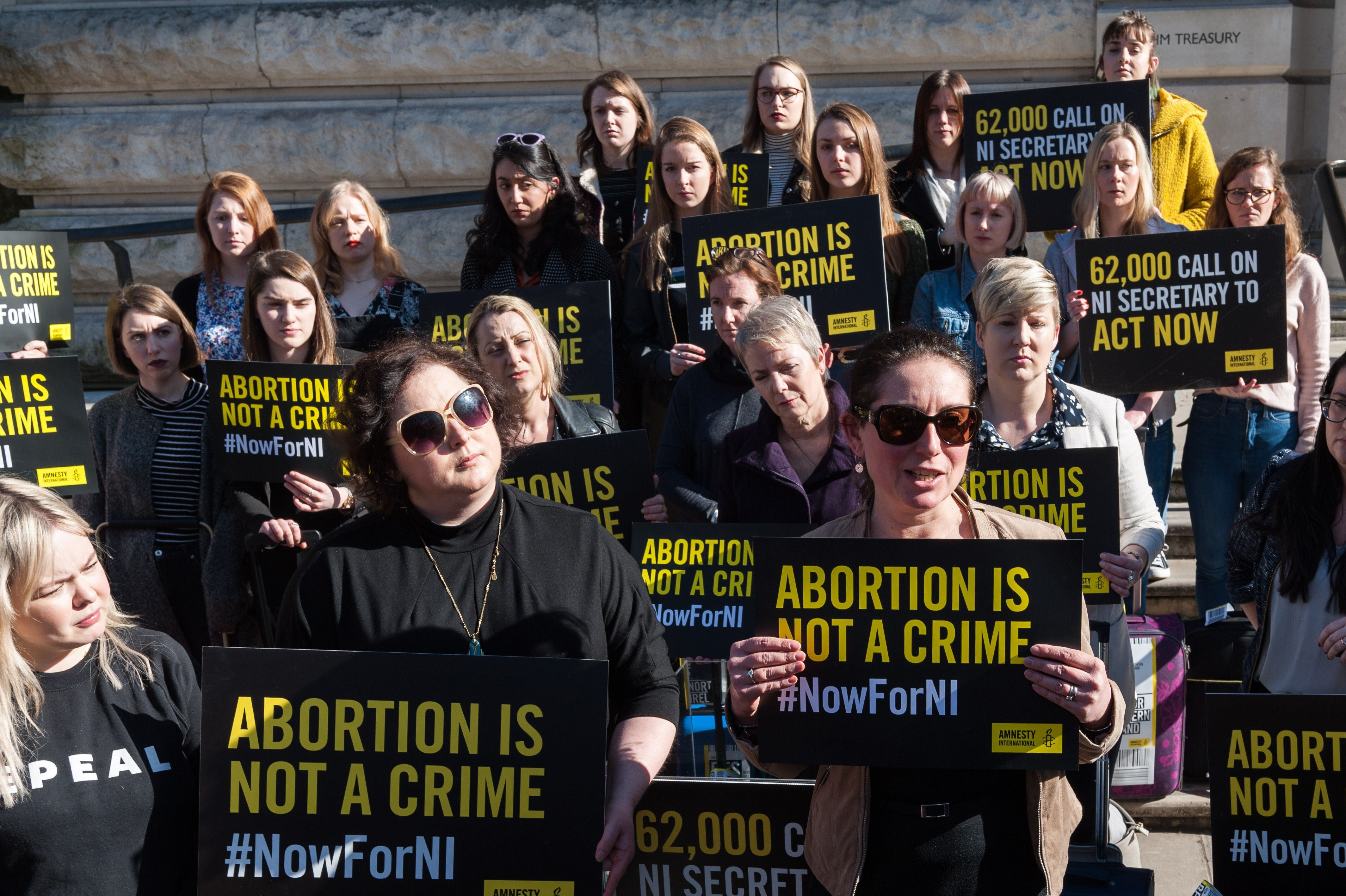 LONDON, UNITED KINGDOM - FEBRUARY 26: A group of 28 pro-choice demonstrators including Derry Girls cast, Nicola Coughlan (1L) and Siobhan McSweeney (2L), who represent the number of women who travel from Northern Ireland for an abortion each week protest outside Westminsters Northern Ireland Office. Demonstrators delivered a petition signed by 62,000 people calling for decriminalisation of abortion in the region. February 26, 2019 in London, England. (Photo credit should read Wiktor Szymanowicz / Barcroft Media via Getty Images)