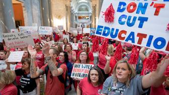 Teachers from across Kentucky gather inside the state Capitol to rally for increased funding and to protest changes to their state funded pension system, Friday, April 13, 2018, in Frankfort, Ky. (AP Photo/Bryan Woolston)