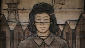 A terra cotta frieze, by artist Steve Gardner, depicts an imprisoned schoolgirl at the Japanese American Exclusion Memorial on Puget Sound's Bainbridge Island, Washington, U.S. February 12, 2017. The island's Japanese-American community was the first to be sent to World War Two internment camps after President Franklin D. Roosevelt signed executive order 9066 75 years ago, on February 19, 1942. Picture taken February 12, 2017. REUTERS/Chris Helgren  EDITORIAL USE ONLY