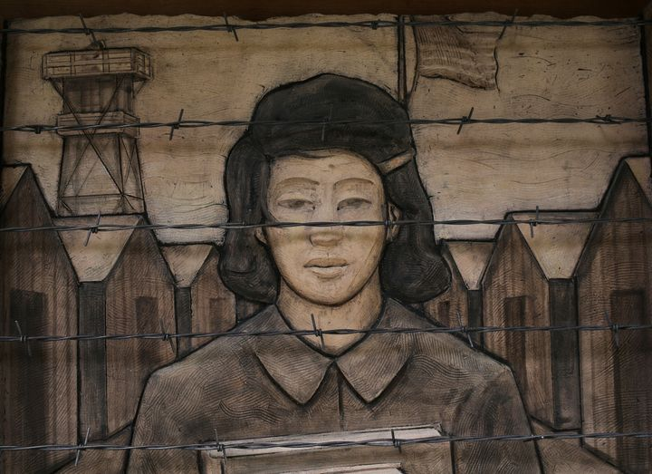 A frieze from the Japanese American Exclusion Memorial on Bainbridge Island, Washington. The memorial lists the names of the
