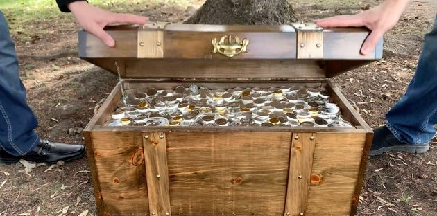 Three chests with $100,000 worth of gold each are buried in Edmonton, Calgary and