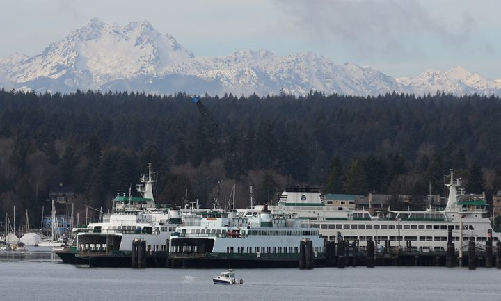 Ferries dock at Bainbridge Island, Washington, with the Olympic Mountains in the background.