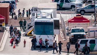 Migrants board buses to take them to shelters after being released from migration detention as construction of a new migrant processing facility is underway at the Customs and Border Protection - El Paso Border Patrol Station on the east side of El Paso on April 28, 2019. - Migrants kept behind concertina and barbed wire underneath the the Paso Del Norte International Bridge in downtown El Paso were moved to temporary tents here after major outcry against the practice. (Photo by Paul RATJE / AFP)        (Photo credit should read PAUL RATJE/AFP/Getty Images)