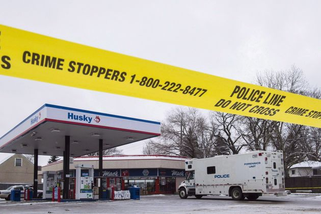 Homicide detectives investigate at a Mac's convenience store in Edmonton on Dec. 18,