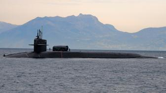 The guided missile submarine USS Florida (SSGN 728) pulls into the Bay of Naples, Italy in this file photo taken in the Mediterranean Sea on March 4, 2011 and released to Reuters on March 19, 2011. U.S. and British ships and submarines launched missile strikes against Libya on Saturday, officials said, as the West began a first phase of its military operations to force Muammar Gaddafi from power.   REUTERS/Daniel Viramontes/U.S. Navy photo/Handout   (ITALY - Tags: MILITARY POLITICS CIVIL UNREST CONFLICT) FOR EDITORIAL USE ONLY. NOT FOR SALE FOR MARKETING OR ADVERTISING CAMPAIGNS. THIS IMAGE HAS BEEN SUPPLIED BY A THIRD PARTY. IT IS DISTRIBUTED, EXACTLY AS RECEIVED BY REUTERS, AS A SERVICE TO CLIENTS
