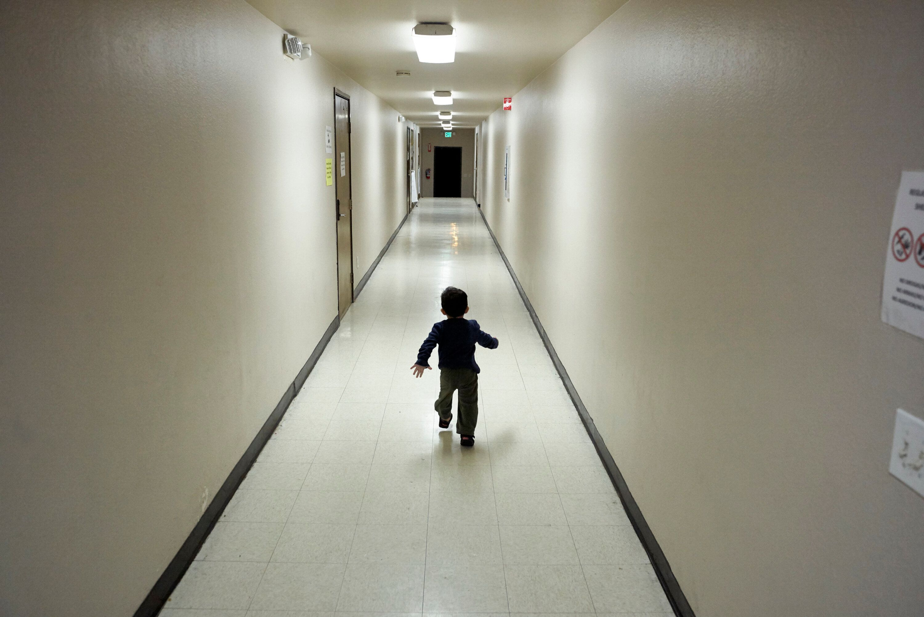 FILE - In this Dec. 11, 2018 file photo, an asylum-seeking boy from Central America runs down a hallway after arriving from an immigration detention center to a shelter in San Diego. Immigrant advocates say they are suing the U.S. government for allegedly detaining immigrant children too long and improperly refusing to release them to relatives. Lawyers said Tuesday, Jan. 22, 2019 they expanded a lawsuit filed last year in federal court in Alexandria, Va., to propose including the cases of more than 10,000 children. (AP Photo/Gregory Bull, file)