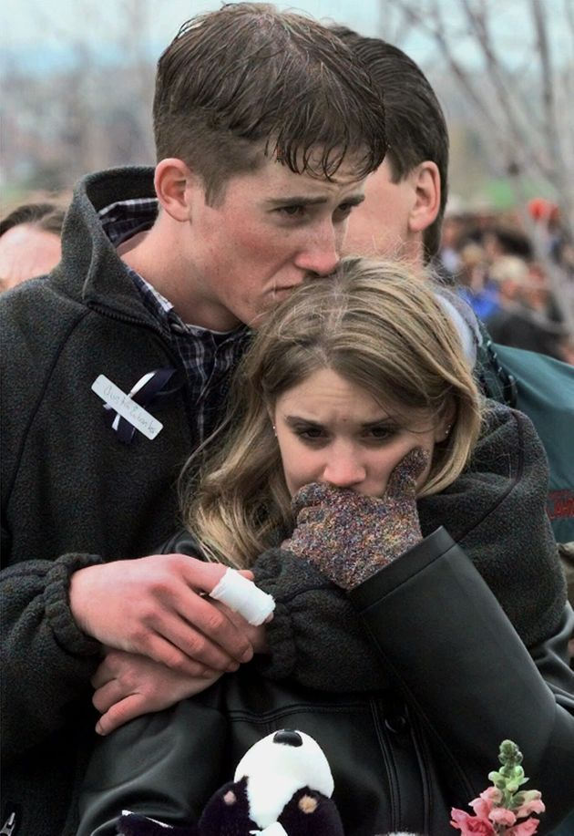 In this April 25, 1999 photo, Columbine High School shooting victim Austin Eubanks hugs his girlfriend...