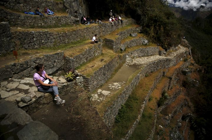 A tourist rests while sitting on terraces at the Inca citadel of Machu Picchu in Cuzco, Peru, in 2015.