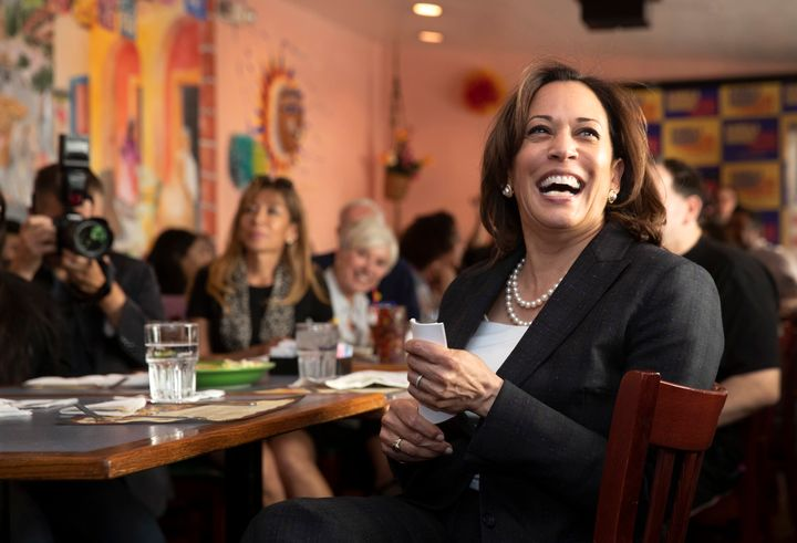 Democratic presidential candidate Sen. Kamala Harris (D-Calif.) laughs as she waits to be introduced during a Hispanics in Po