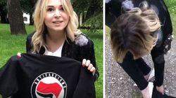 La candidata di Fratelli d'Italia si pulisce i tacchi con la t-shirt antifascista: