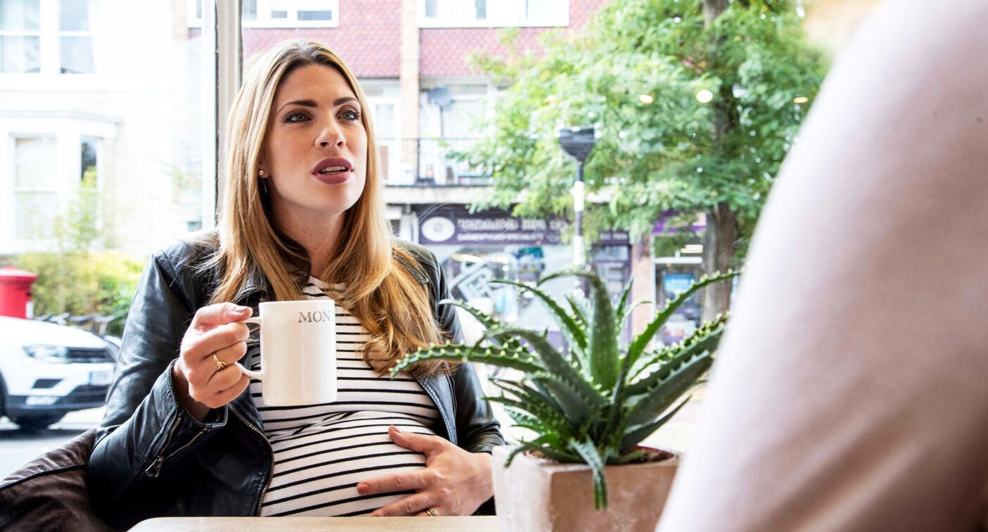 A pregnant woman, posed by model, has been shamed for drinking coffee. [Photo: Getty]