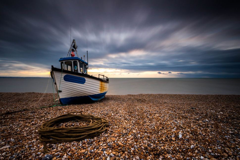 Boat at Sunrise: A moody sunrise and a long exposure led to this stunning shot, taken in Dungeness.