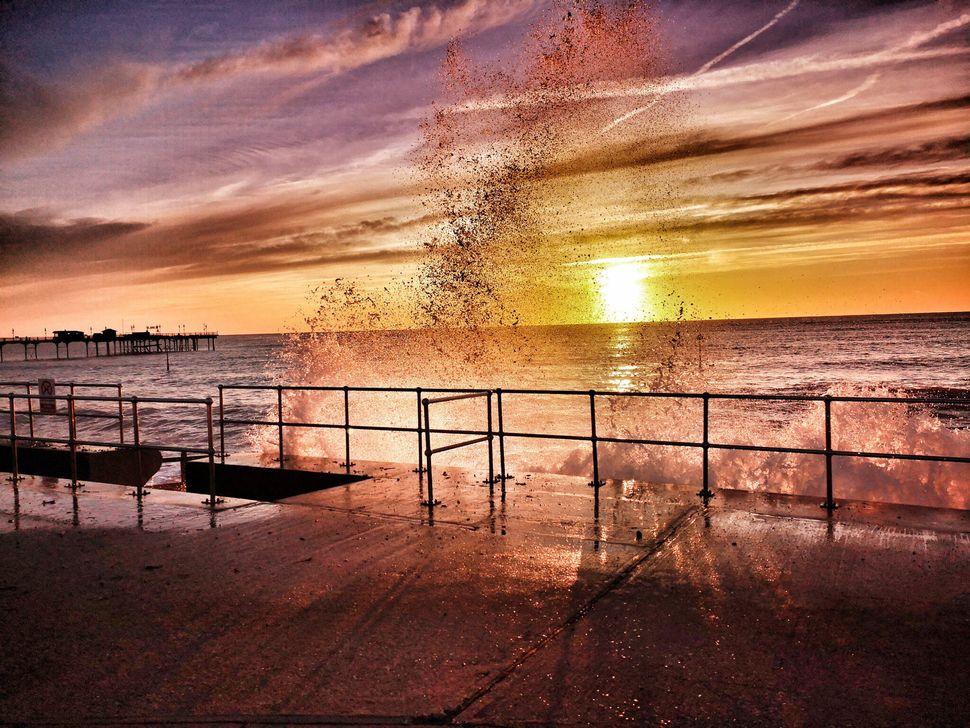 Wild sea: Sea water cascades over the pier in this shot, taken in Teignmouth, Devon.