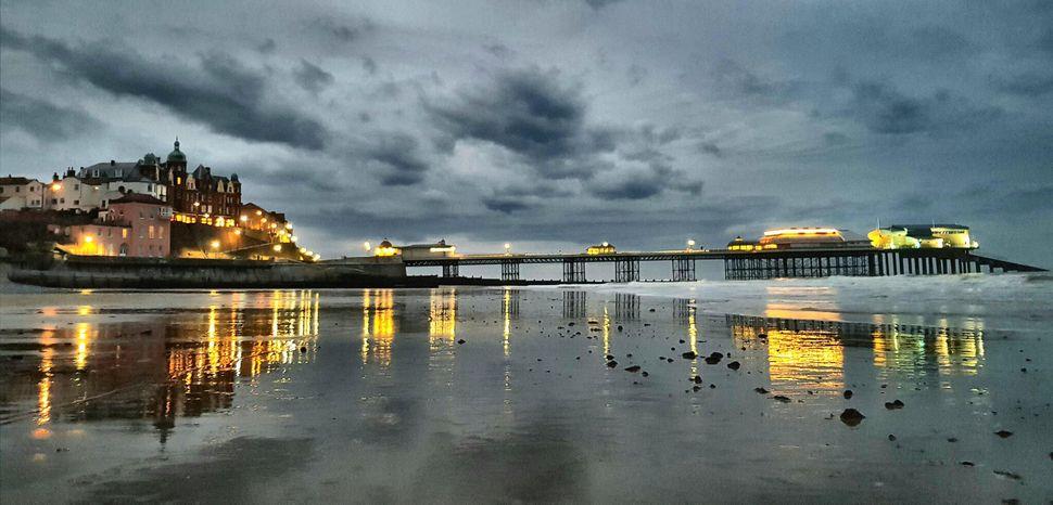 A race against the falling light: Taken at dusk at Cromer Pier, Haverhill.