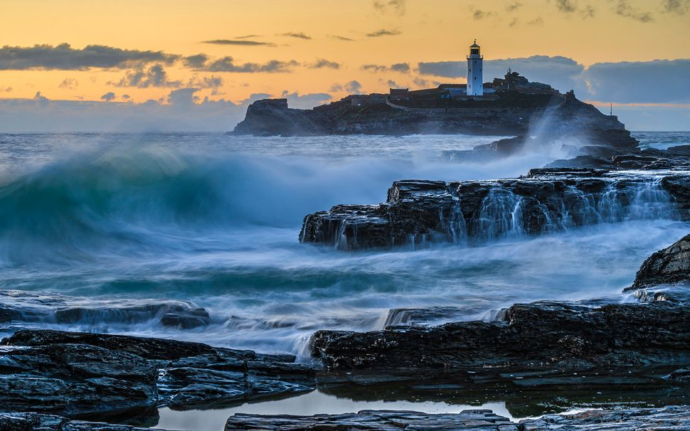 The storm before the rest: Waves break on the rocks of Godrevy, Cornwall on an otherwise quiet evening.