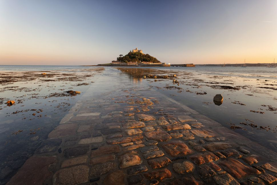 Late evening light bounces from the causeway in this shot of St Michaels Mount, Cornwall.