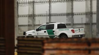 TIJUANA, MEXICO - JANUARY 17: A border patrol truck guards next to border fencing in the city of Tijuana on January 17, 2019 in Tijuana, Mexico. Tijuana has experienced a surge in Central Americans seeking to cross the border into America. The U.S. government is partially shut down as President Trump is asking for $5.7 billion to build additional walls along the U.S.-Mexico border and the Democrats oppose the idea. (Photo by Spencer Platt/Getty Images)