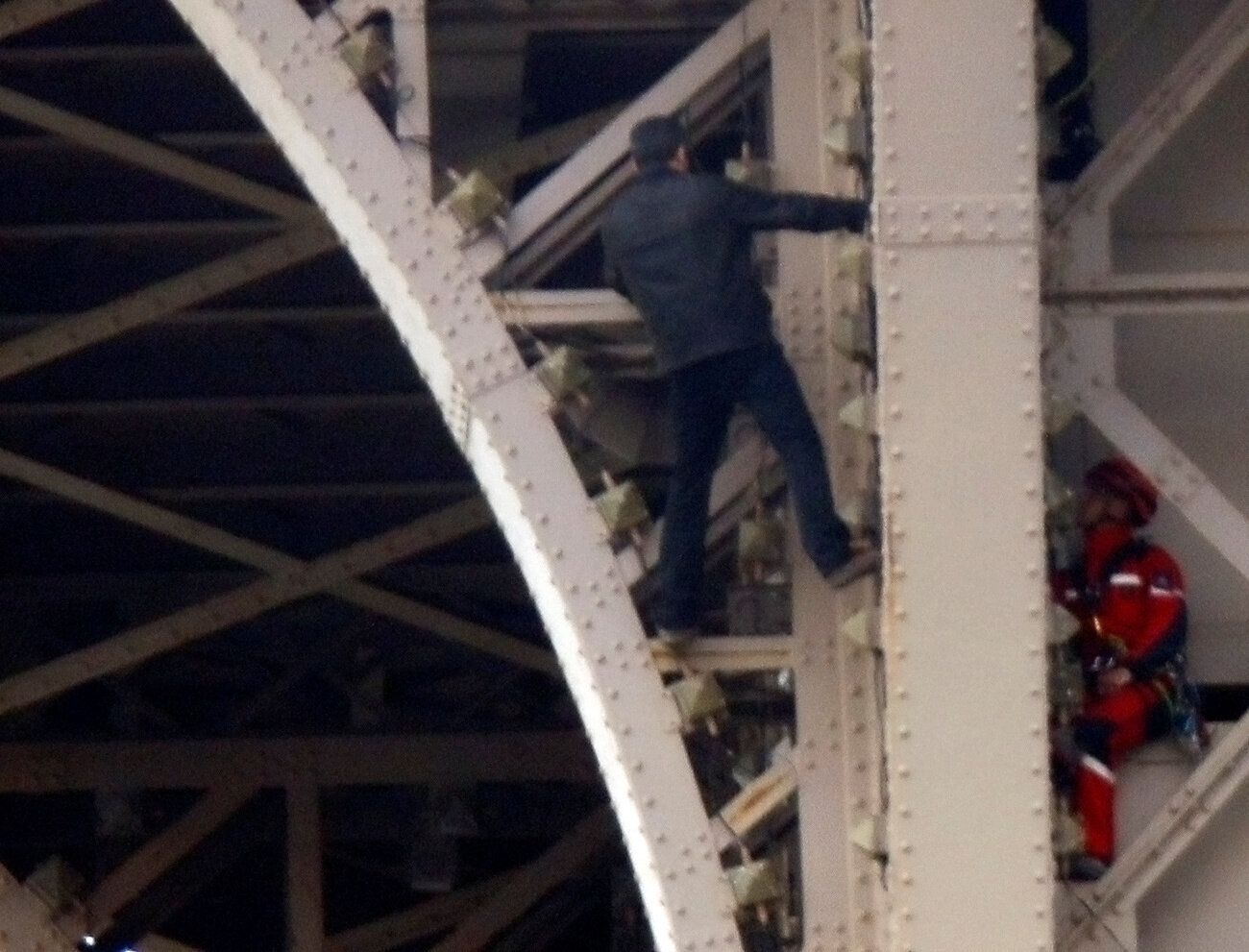 Eiffel Tower Evacuated After Man Starts Climbing It