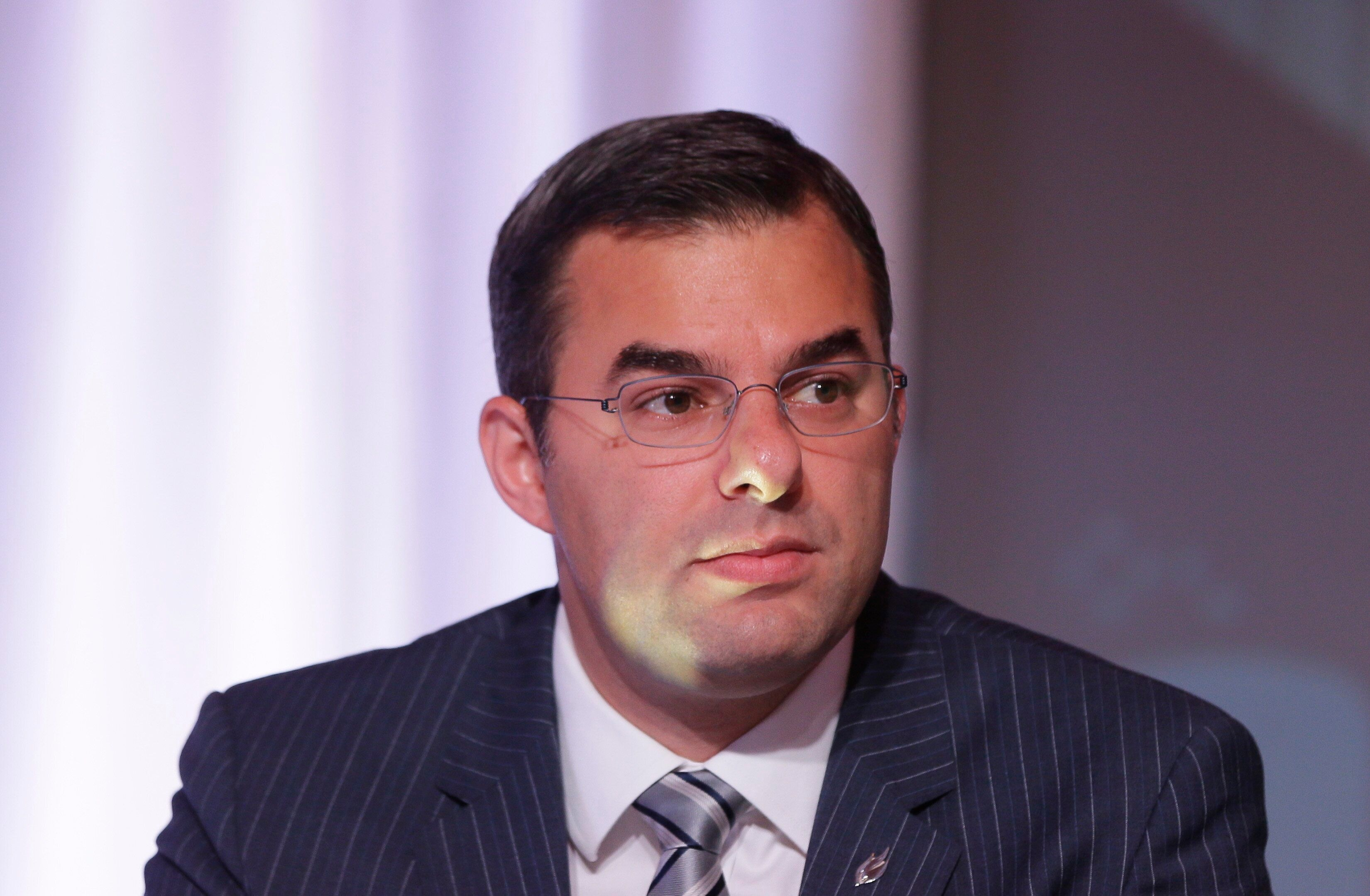 U.S. Rep. Justin Amash, R-Mich., is seen during a congressional panel at the 2016 Mackinac Republican Leadership Conference, Saturday, Sept. 19, 2015, in Mackinac Island, Mich. (AP Photo/Carlos Osorio)