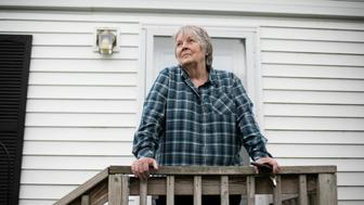 Taunton, MA -- 05/19/19 -- Kathy Zorotheos poses for a portrait outside of her home in the resident-owned Oak Hill Mobile Home Park, on May 19, 2019, in Taunton, Massachusetts. (Kayana Szymczak for The Huffington Post)