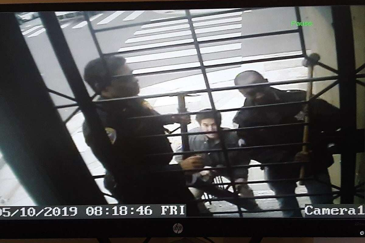 Surveillance video screengrab shows SFPD trying to break into Carmody's home.