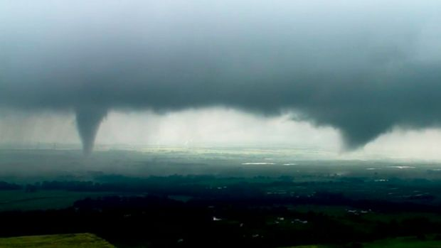 "This image made from video provided by KWTV-KOTV shows two funnel clouds formed in Crescent, Okla., Monday, May 20, 2019. An intense storm system that weather forecasters labeled ""particularly dangerous"" swept through the Southern Plains Monday, spawning a few tornadoes that caused some damage and a deluge of rain but no reports of injuries. (KWTV-KOTV via AP)"