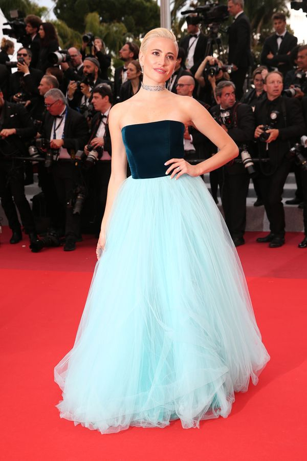 "The singer wears a gown by Yanina Couture for the screening of ""La Belle Epoque."""
