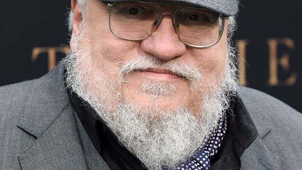 """Author George R.R. Martin poses at the premiere of the film """"Tolkien"""" at the Regency Village Theatre, Wednesday, May 8, 2019, in Los Angeles. The film explores the formative years of J.R.R. Tolkien, author of the classic fantasy novels """"The Hobbit"""" and """"The Lord of the Rings."""" (Photo by Chris Pizzello/Invision/AP)"""