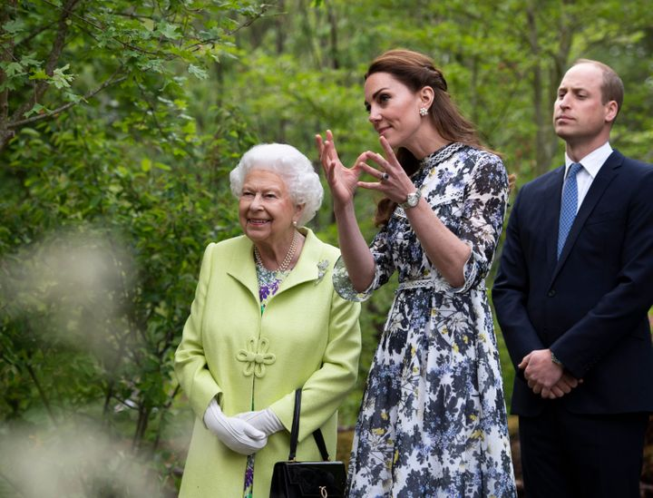 The duchess explaining certain parts of the garden.