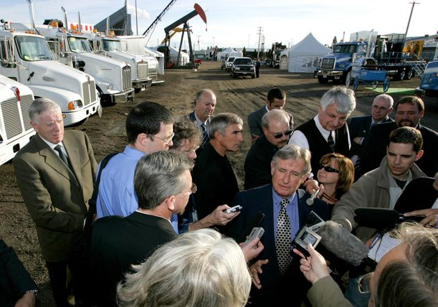 Alberta Premier Ralph Klein speaks to reporters at the Lloydminster Heavy Oil Show on Sept. 14, 2004,...