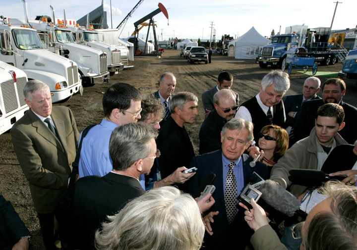 Alberta Premier Ralph Klein speaks to reporters at the Lloydminster Heavy Oil Show on Sept. 14, 2004, in Lloydminster, Alta.