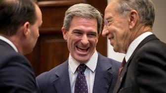From left, Sen. Mike Lee, R-Utah, former Virginia Attorney General Ken Cuccinelli, and Sen. Chuck Grassley, R-Iowa, laugh before President Donald Trump arrived to announce his support for the first major rewrite of the nation's criminal justice sentencing laws in a generation in the Roosevelt Room of the White House in Washington, Wednesday, Nov. 14, 2018. (AP Photo/Andrew Harnik)