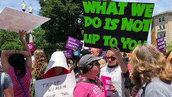 People demonstrate at the National Day of Action to Stop the Bans in Washington, D.C., on Tuesday.