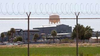 """FILE - This July 23, 2014 file photo shows a state prison in Florence, Ariz. A book that discusses the impact of the criminal justice system on black men is being kept out of the hands of Arizona prison inmates. The American Civil Liberties Union is calling on the Arizona Department of Corrections to rescind a ban on """"Chokehold: Policing Black Men."""" (AP Photo/File)"""