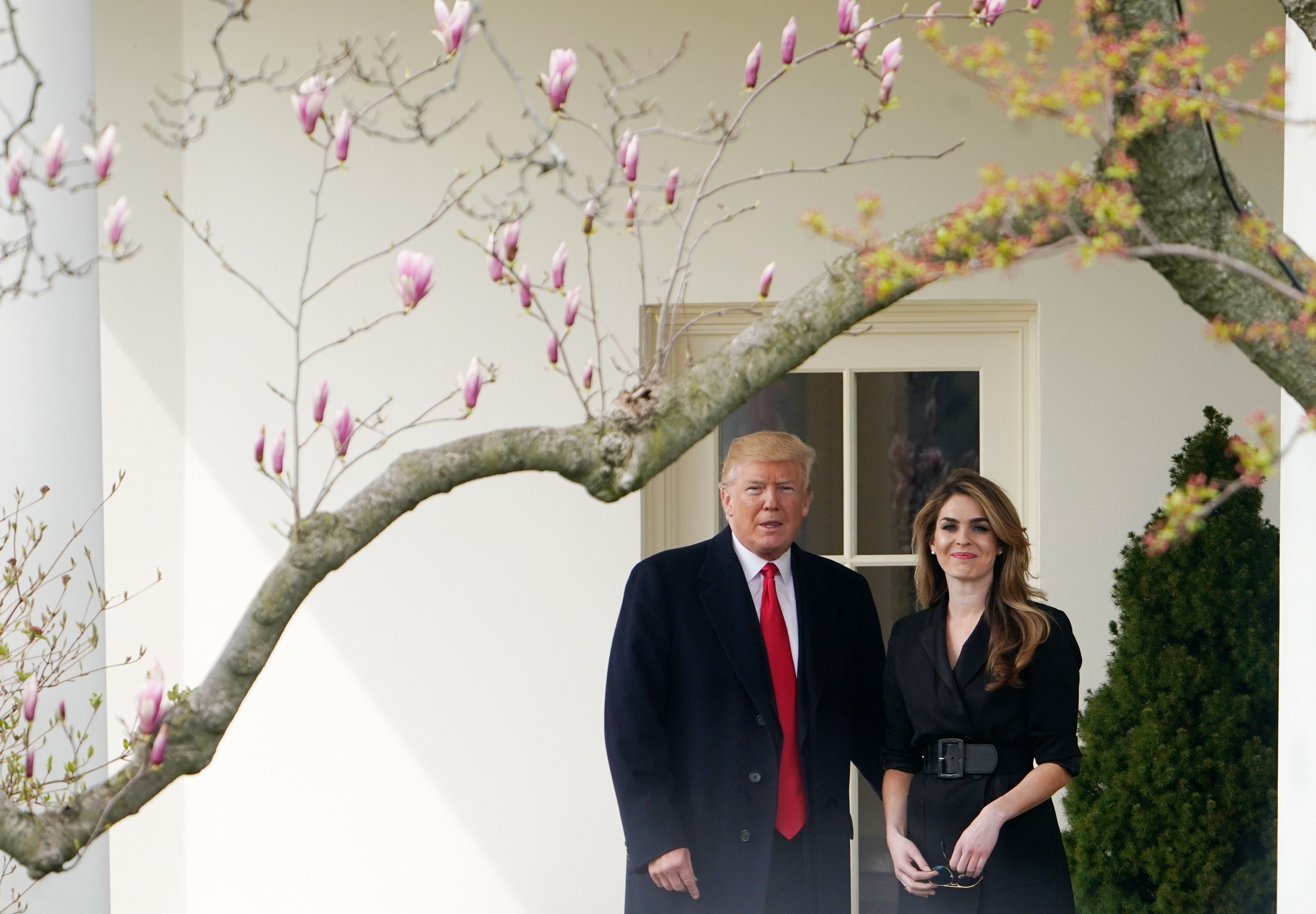 US President Donald Trump poses for a photo with former communications director Hope Hicks shortly before making his way to board Marine One on the South Lawn and departing from the White House in Washington, DC on March 29, 2018.  Trump is visiting Ohio to speak on infrastructure development before heading to Palm Beach, Florida.  / AFP PHOTO / Mandel NGAN        (Photo credit should read MANDEL NGAN/AFP/Getty Images)