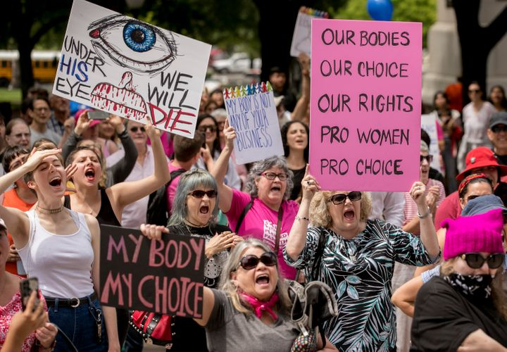 Abortion rights advocates rally at the Capitol in Austin, Texas, on Tuesday to oppose state laws that impose strict restricti