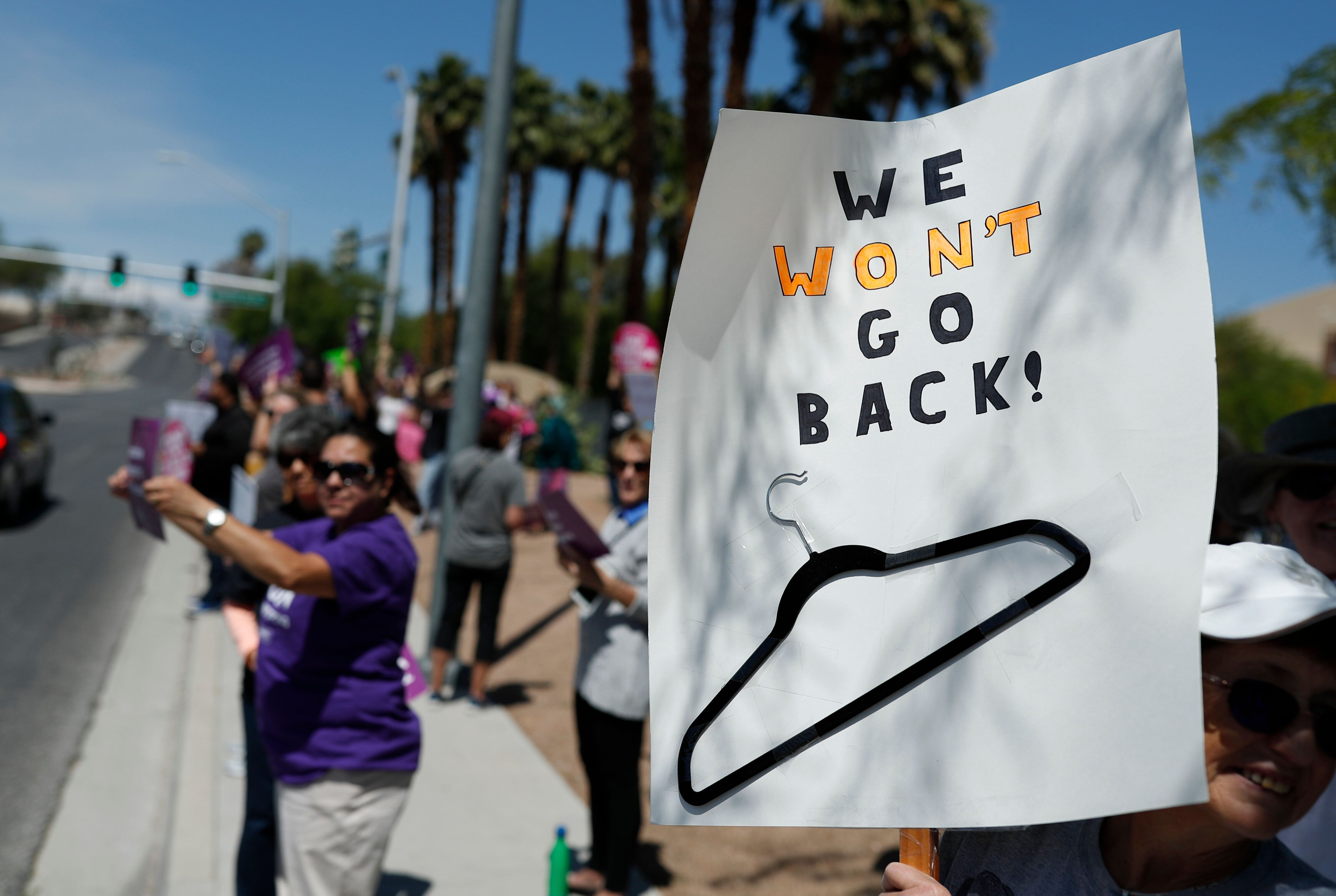People rally in support of abortion rights Tuesday, May 21, 2019, in Las Vegas. (AP Photo/John Locher)