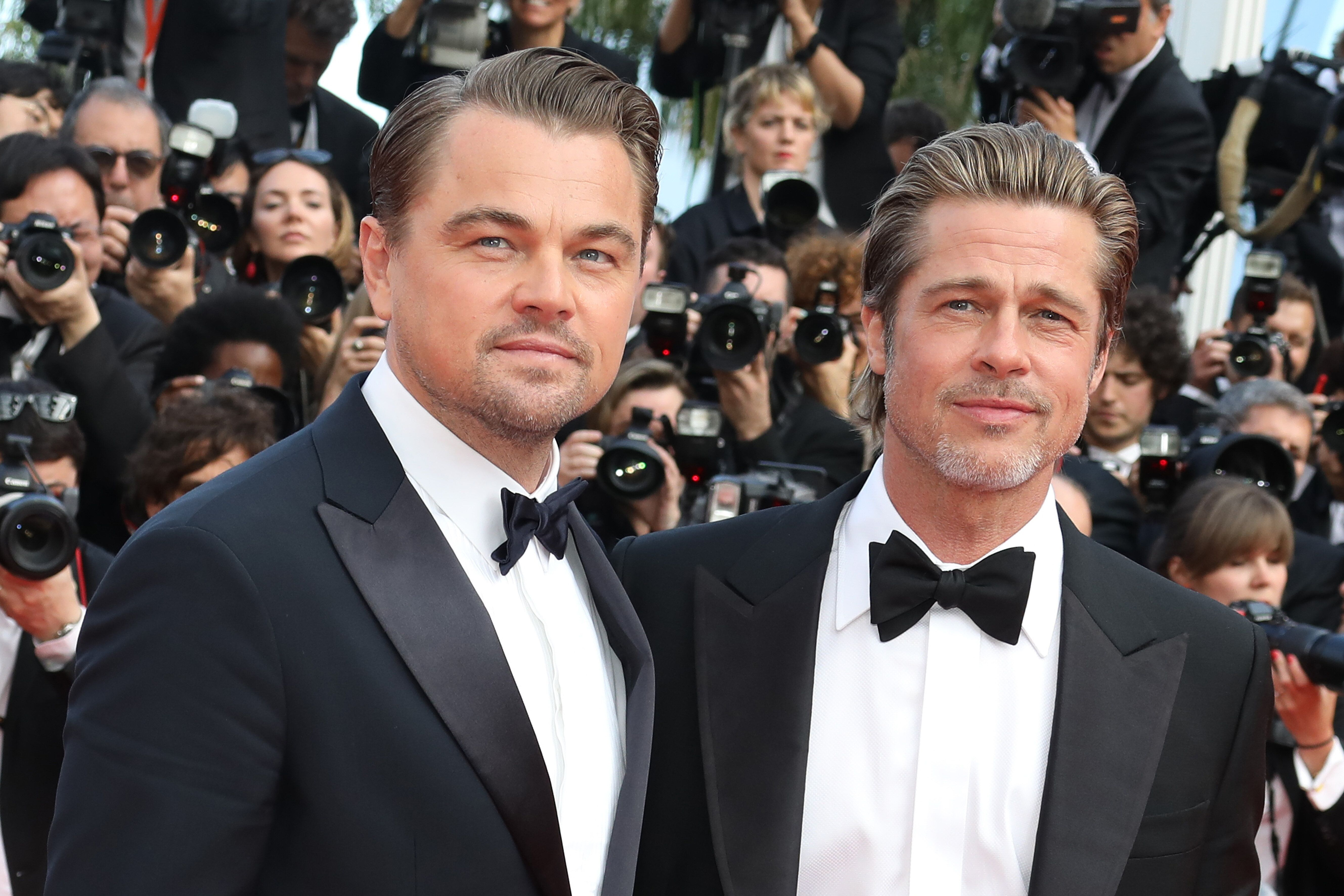 """CANNES, FRANCE - MAY 21: Brad Pitt and Leonardo DiCaprio attend the screening of """"Once Upon A Time In Hollywood"""" during the 72nd annual Cannes Film Festival on May 21, 2019 in Cannes, France. (Photo by Tony Barson/FilmMagic)"""
