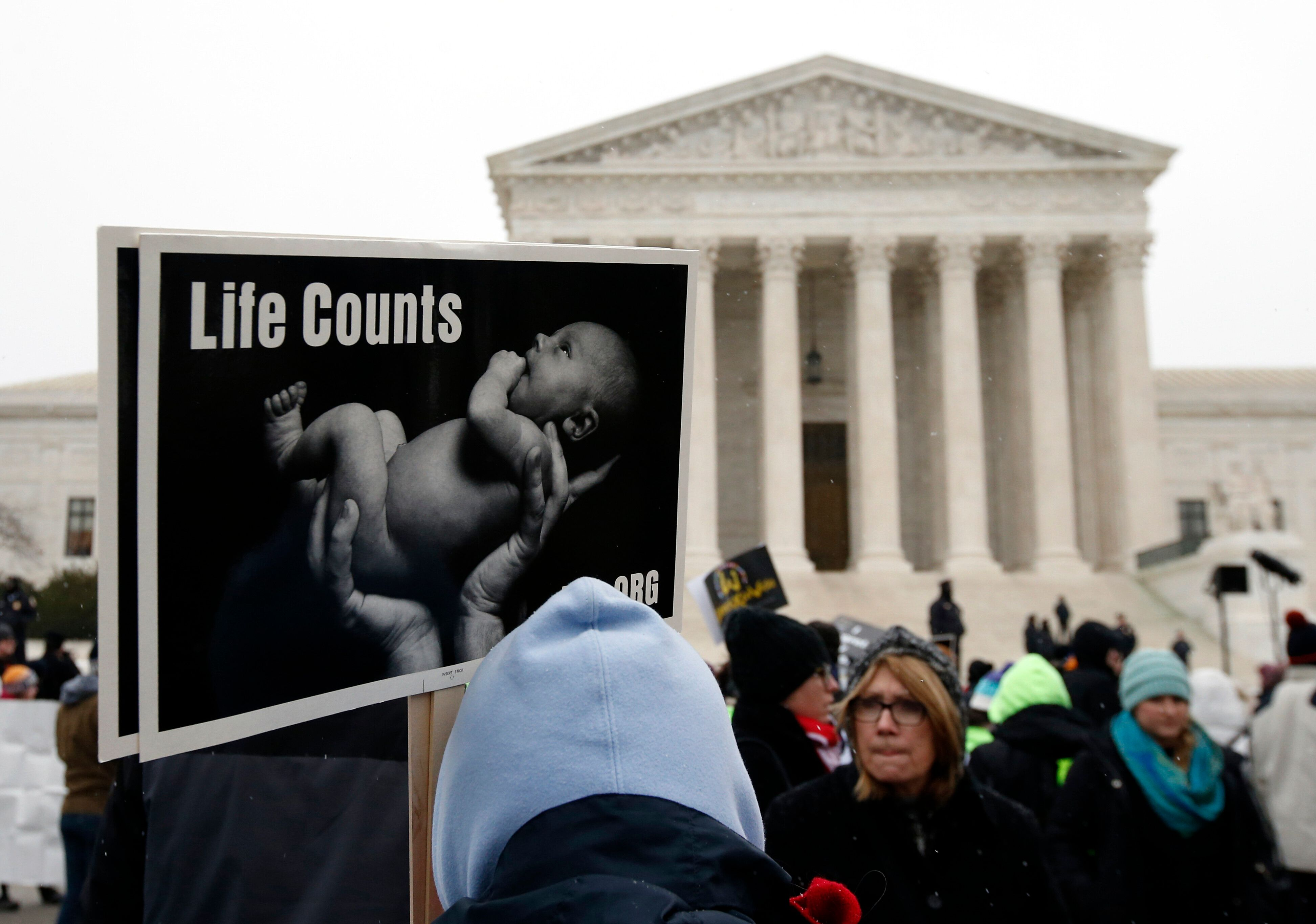 A marcher holds a sign during the March for Life 2016, in front of the U.S. Supreme Court,  Friday, Jan. 22, 2016 in Washington. January 22 is the anniversary of 1973 'Roe v. Wade' U.S. Supreme Court decision legalizing abortion. (AP Photo/Alex Brandon)