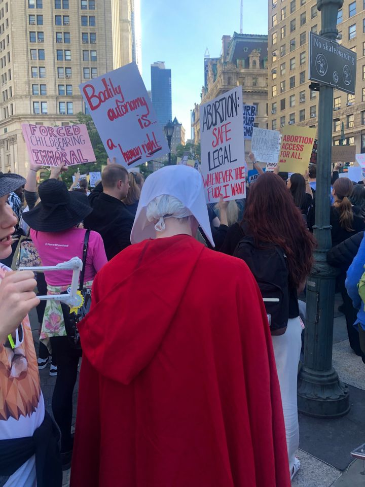 "A protester dressed in a ""Handmaid's Tale"" outfit at the Foley Square #StopTheBans protest in New York City."