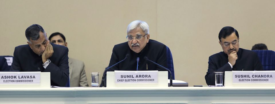 DIVIDED HOUSE: India's Chief Election Commissioner Sunil Arora, center, with other two election commissioners...