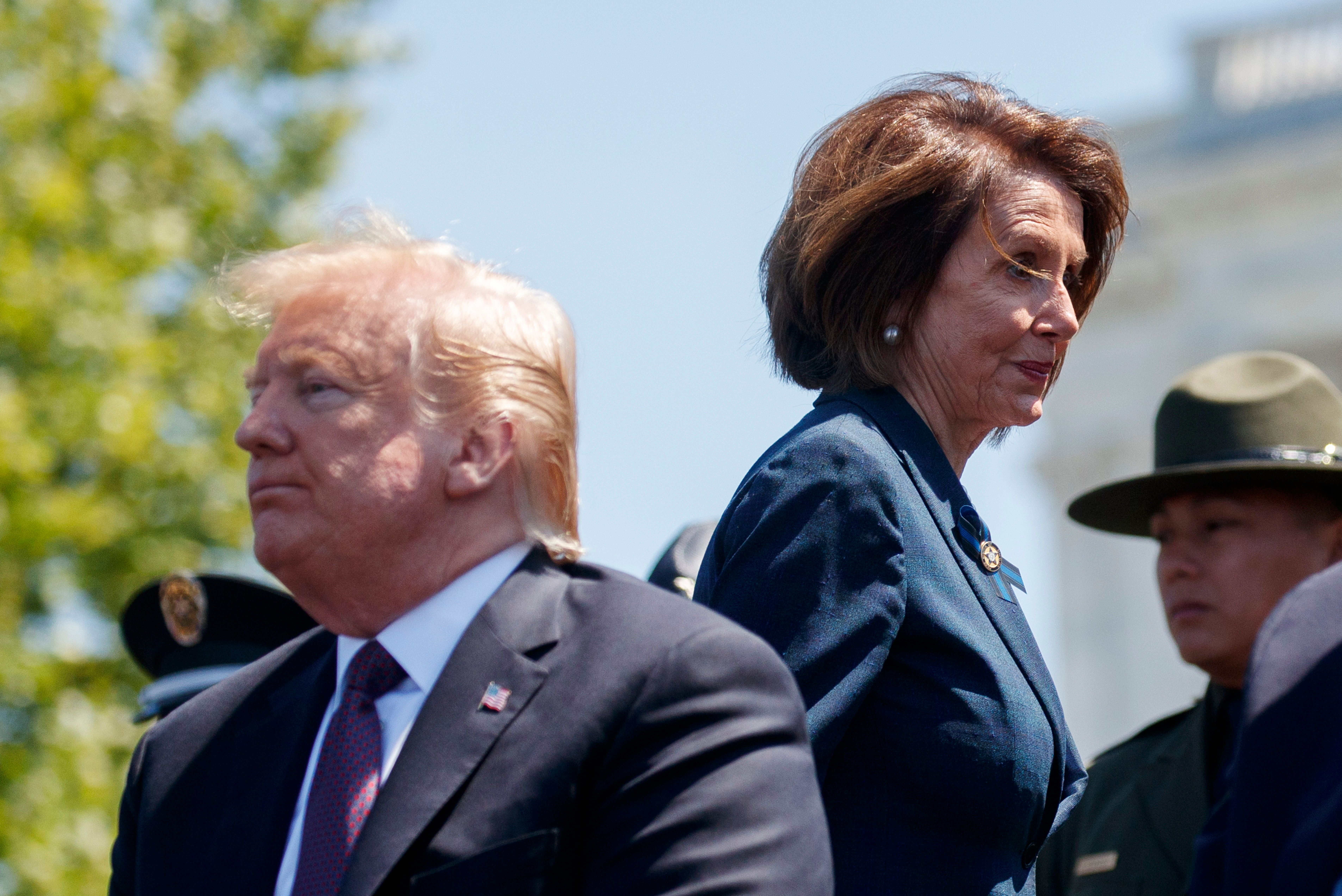 """President Donald Trump and Speaker of the House Nancy Pelosi of Calif., attend the 38th Annual National Peace Officers' Memorial Service at the U.S. Capitol, Wednesday, May 15, 2019, in Washington. Pelosi said Wednesday that the U.S. must avoid war with Iran and she warned the White House has """"no business"""" moving toward a Middle East confrontation without approval from Congress.  (AP Photo/Evan Vucci)"""
