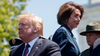 "President Donald Trump and Speaker of the House Nancy Pelosi of Calif., attend the 38th Annual National Peace Officers' Memorial Service at the U.S. Capitol, Wednesday, May 15, 2019, in Washington. Pelosi said Wednesday that the U.S. must avoid war with Iran and she warned the White House has ""no business"" moving toward a Middle East confrontation without approval from Congress.  (AP Photo/Evan Vucci)"