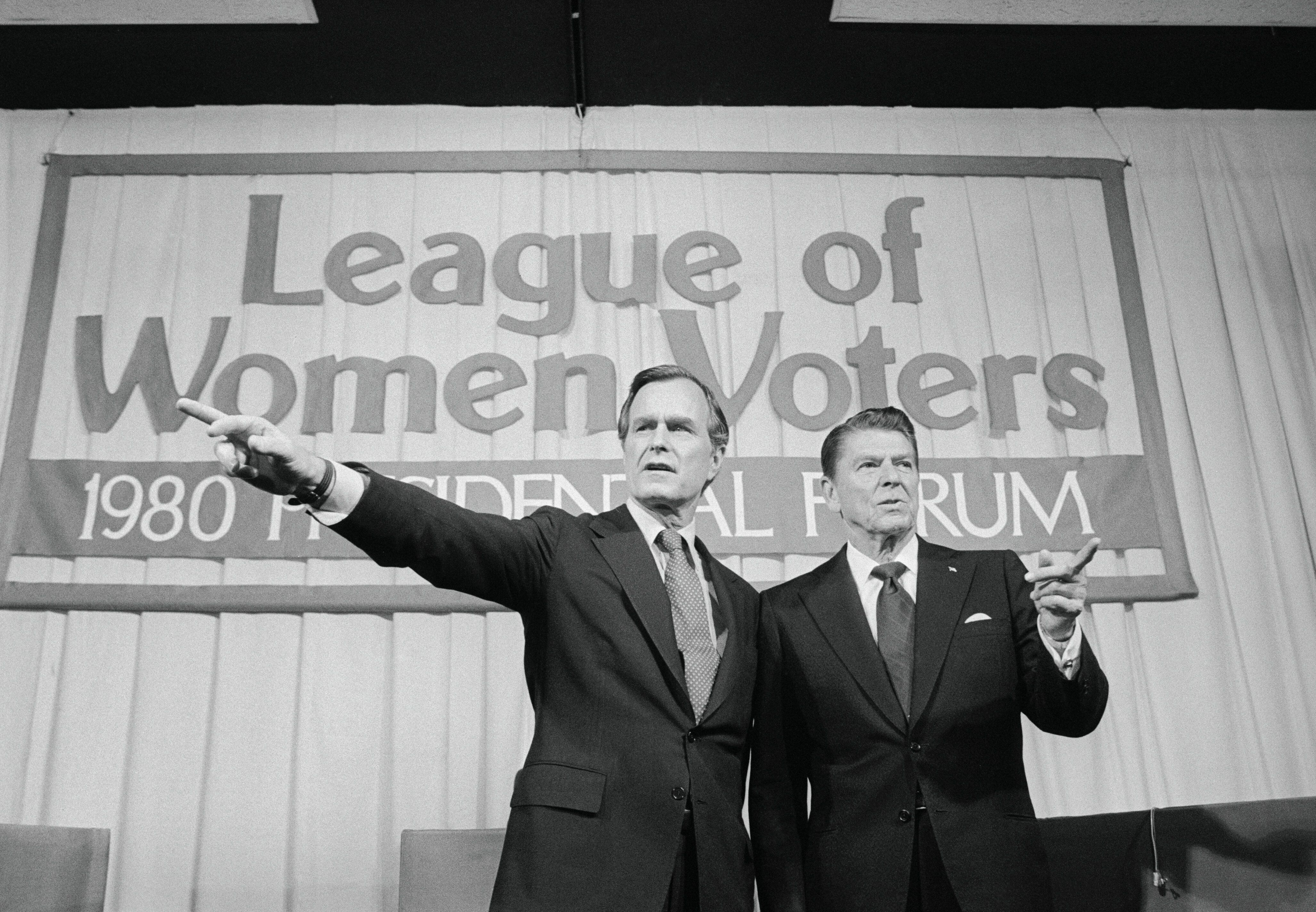 (Original Caption) Houston: George Bush (L) and Ronald Reagan stand together, but points toward different directions before the start of their debate before the League of Women Voters Forum. The GOP Presidential contenders disagreed about tax cuts and blockades, but did agree that Jimmy Carter must be driven from the White House.