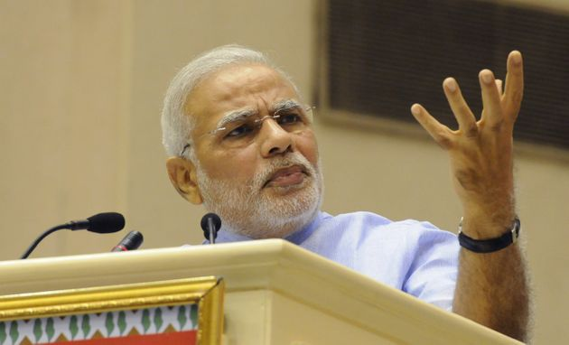 Prime Minister Narendra Modi speaks during the launch of Pradhan Mantri Jan Dhan Yojna at Vigyan Bhawan...