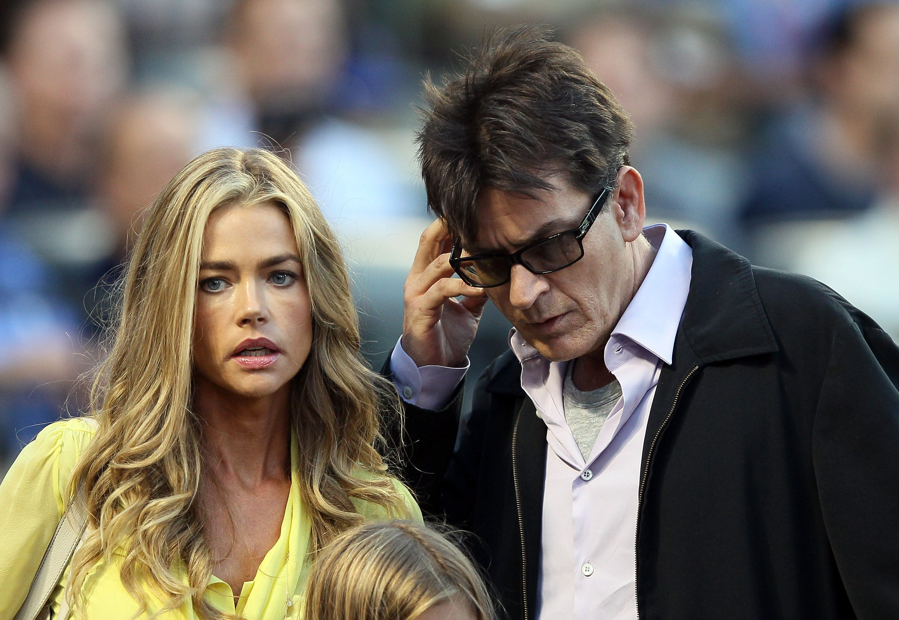 NEW YORK, NY - JUNE 23:  Denise Richards and Charlie Sheen look for their seats as the New York Yankees take on the New York Mets on June 23, 2012 during interleague play at Citi Field in the Flushing neighborhood of the Queens borough of New York City.  (Photo by Elsa/Getty Images)