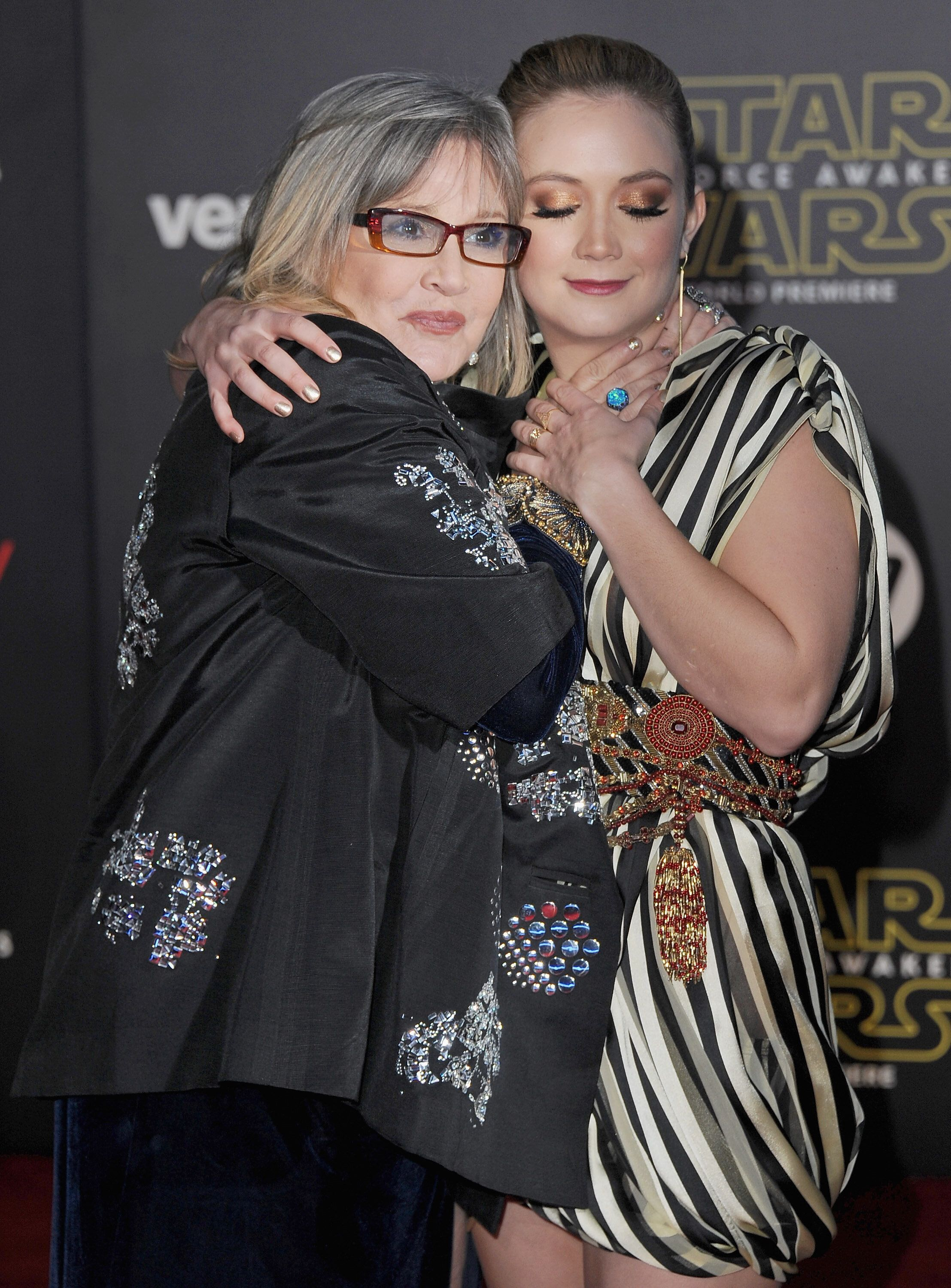 "HOLLYWOOD, CA - DECEMBER 14:  Actress Carrie Fisher and daughter Billie Lourd arrive at the Los Angeles Premiere ""Star Wars: The Force Awakens"" on December 14, 2015 in Hollywood, California.  (Photo by Jon Kopaloff/FilmMagic)"