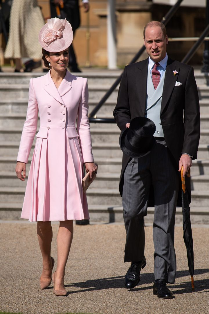 Prince William and Catherine, Duchess of Cambridge attending the Royal Garden Party at Buckingham Palace on May 21 in London,